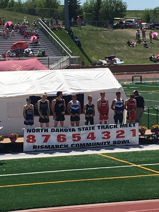 Boys 200 meter dash podium